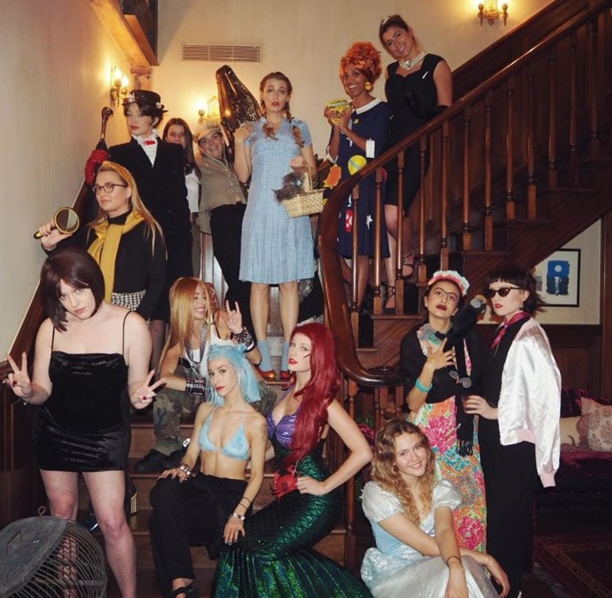 """""""Mary Poppins, Audrey, Ariel, Ms. Frizzle, Cinderella, Gwen, Mr. Toad, Avril, Nancy Drew, Posh Spice, Rizzo, Frida Kahlo, Steve Irwin, Dorothy.. This new year we decided to dress up as our childhood heroes,"""" Swift captioned this Instagram shot of her and her guests on a staircase."""
