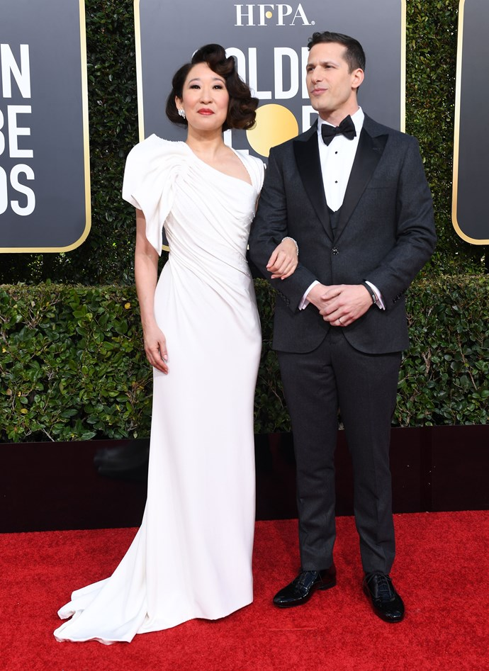 Sandra Oh in Atelier Versace and Andy Samberg.