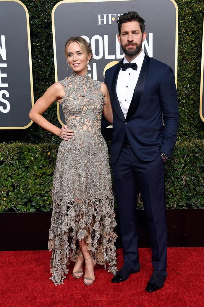 Emily Blunt in Alexander McQueen and John Krasinski.