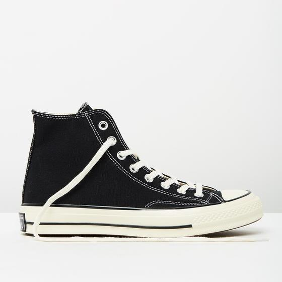 """***Converse All Star '70 High-Top*** <br><br> Though the footwear universe tends to annually flip-flop (no pun intended) between favouring Converse or Vans, All Stars are unarguably back on-trend in 2019. <br><br> *Converse sneakers, $120 at [The Iconic](https://www.theiconic.com.au/chuck-taylor-all-star-70-hi-top-unisex-439107.html
