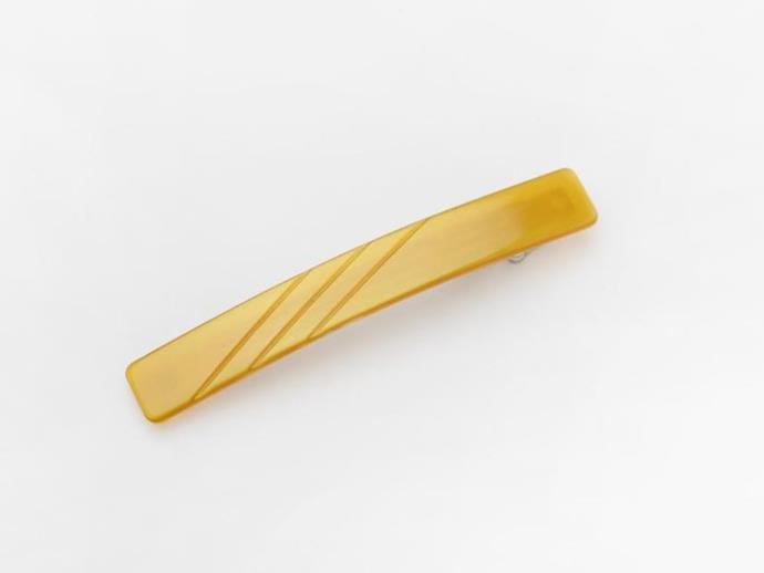 "Leah Barrette, $30 at [Valet](https://valetstudio.com/collections/hair/products/classic-yellow-barrette|target=""_blank""