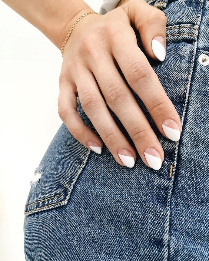 """*Pure White*<br><br> It's hard to go past a crisp white manicure, says Papadopoulos. """"It's a classic, and pairs perfectly with tanned skin in summer months. Just add gold jewellery.""""<br><bR> Image via [@nailplace.manicure](https://www.instagram.com/p/BkVa785F32V/ target=""""_blank"""" rel=""""nofollow"""")."""