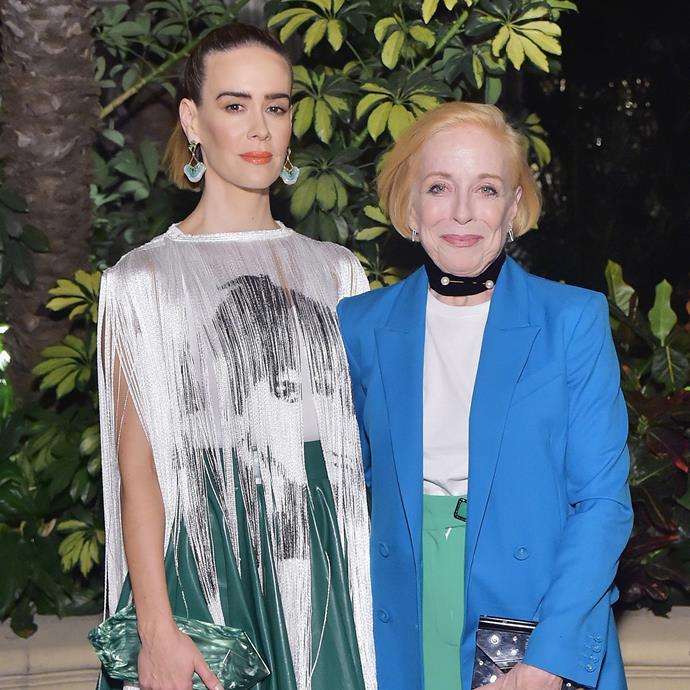 """***Sarah Paulson & Holland Taylor*** <br><br> *American Horror Story* actress Paulson revealed that she met her girlfriend Holland Taylor years ago, when they were both in different relationships—but that they reunited through Twitter. <br><br> In a 2019 interview on talk show *Watch What Happens Live*, Paulson said she and Taylor """"breezed by each other"""" during an event at actress Martha Plimpton's house years ago, which led to them rekindling on social media. When fellow guest Billy Eichner said """"Holland Taylor slid into your DMs?!"""", Paulson replied: """"She actually did!"""""""