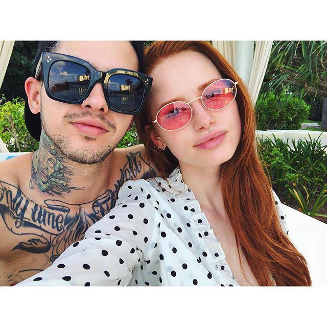 """***Madelaine Petsch & Travis Mills*** <br><br> *Riverdale* actress Petsch first spoke to her boyfriend in January 2017, after he sent her a message congratulating her on her role in the show. While they knew each other through mutual friends, their online chatting soon led to a real-life relationship, which lasted for three years before ending in 2020. <br><br> Petsch gold *[Glamour](https://www.glamour.com/story/madelaine-petsch-relationship