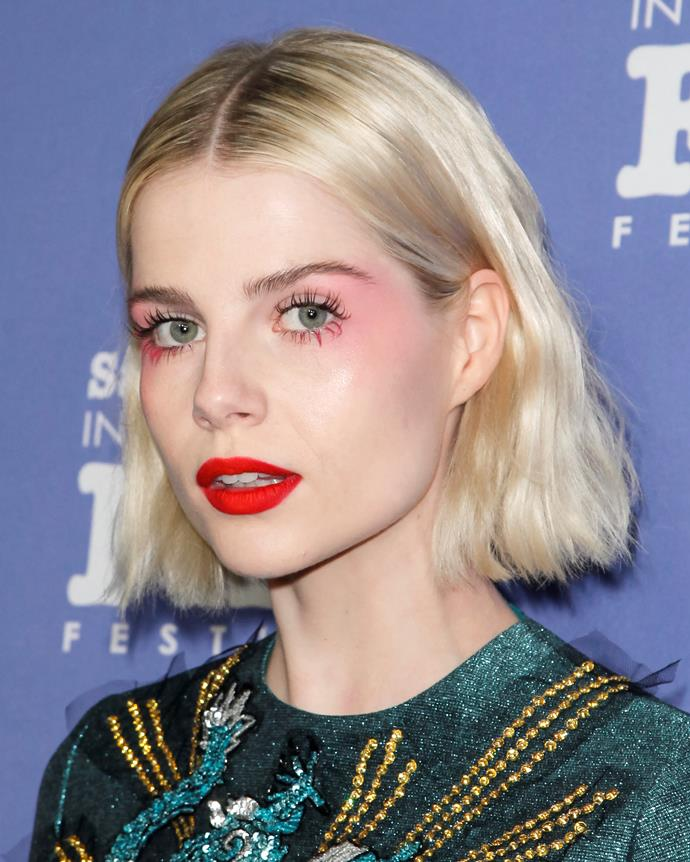 ***February 1, 2019*** <br><br> At the 2019 Santa Barbara Film Festival, Boynton looked ethereal in a bright red shade of lipstick, paired with pink-hued eyeshadow and statement bottom lashes.