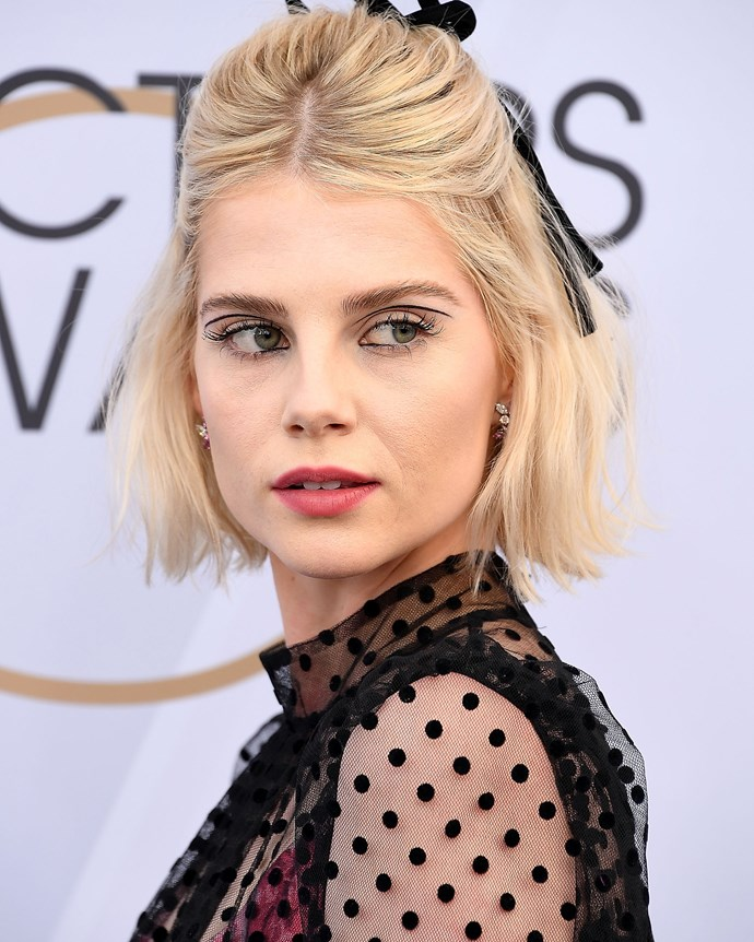 ***January 27, 2019*** <br><br> At the 2019 SAG Awards, Boynton channeled Twiggy by embellishing her lids with a thin line of eye crayon. She finished the mod look off with a 60s-style half-up, half-down hairdo, accessorised with a dainty black ribbon, proving that hair ribbons are 2019's trend du jour