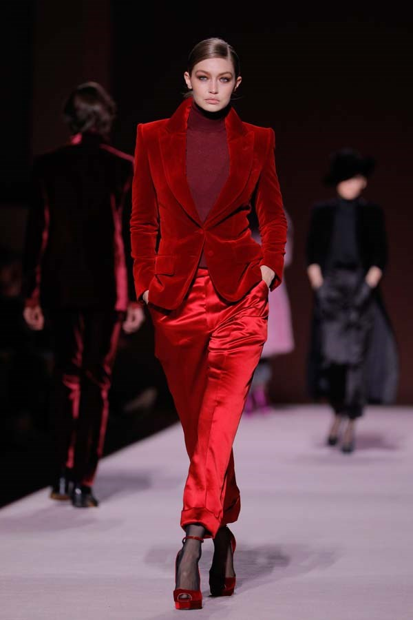 ***THE TEXTURE SPLIT***<br><br> This winter, think tactile. Tom Ford sent Gigi Hadid down the runway in a lush velvet blazer matched with liquid-silk trousers and a woollen turtleneck, cementing texture clashing as a trend to watch. Be mindful of the visual element and pair up silks, velvets, feathers, fake furs, corduroys, sequins and sheers. <br><br> As seen at: Tom Ford autumn/winter '19.