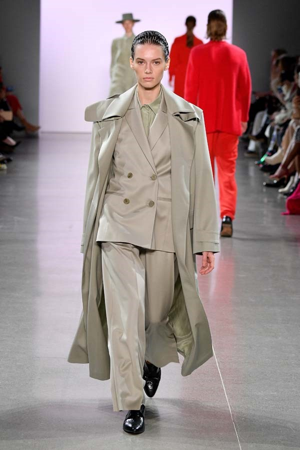 ***SOFT SUITING***<br><br> After a few seasons of sharp, tight silhouettes in bold colours and touchable textures, suiting is relaxing for winter. Think soft colours and soft cuts. Buttermilk yellow, heather grey, oatmeal and sage green silks and cottons draped softly around the shoulders and pooling just the tiniest bit around the legs. The shape-conscious can belt the blazer around the waist, as seen at Tibi and Jonathan Simkhai. <br><br> As seen at: Ryan Roche autumn/winter '19.