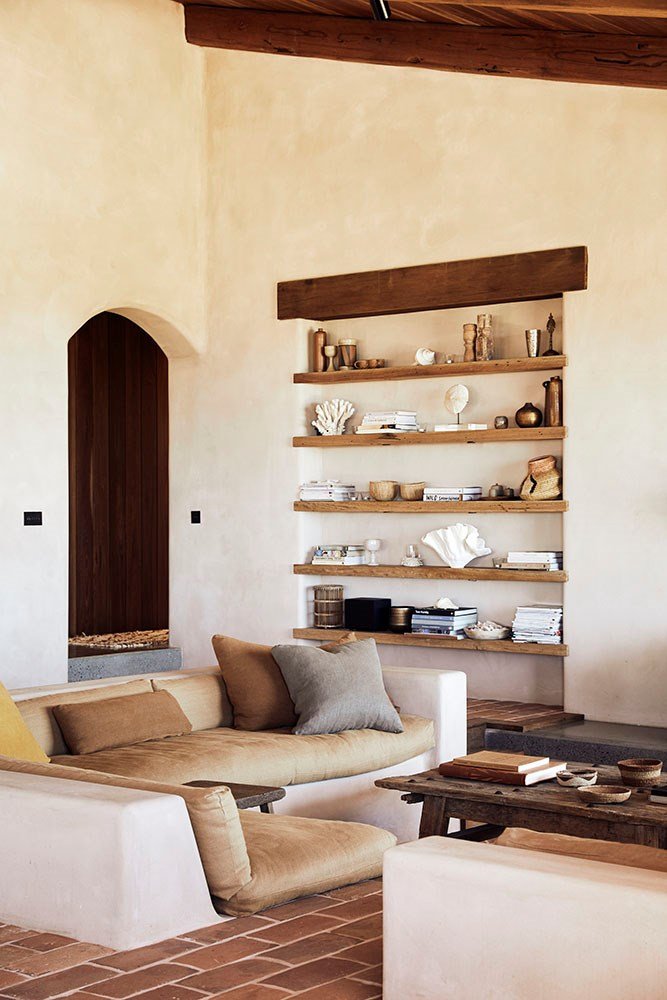 """Emma, whose business ethos of sustainability extends into her home, repurposed several features from the original house such as beams and door frames to create an authentic ode to the heritage of the property. """"The main shelves in the living area are from the old roof trusses,"""" she says."""