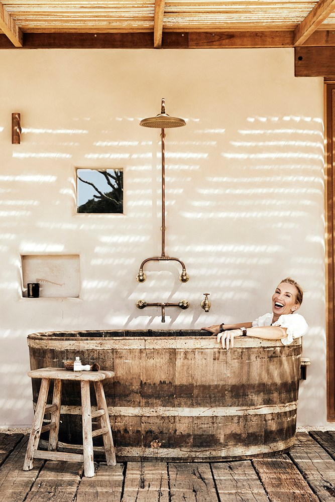 Pre-existing outdoor features have also been kept and given new life, including a rustic industrial bath outside the main bedroom that was once an old wine storage vessel.