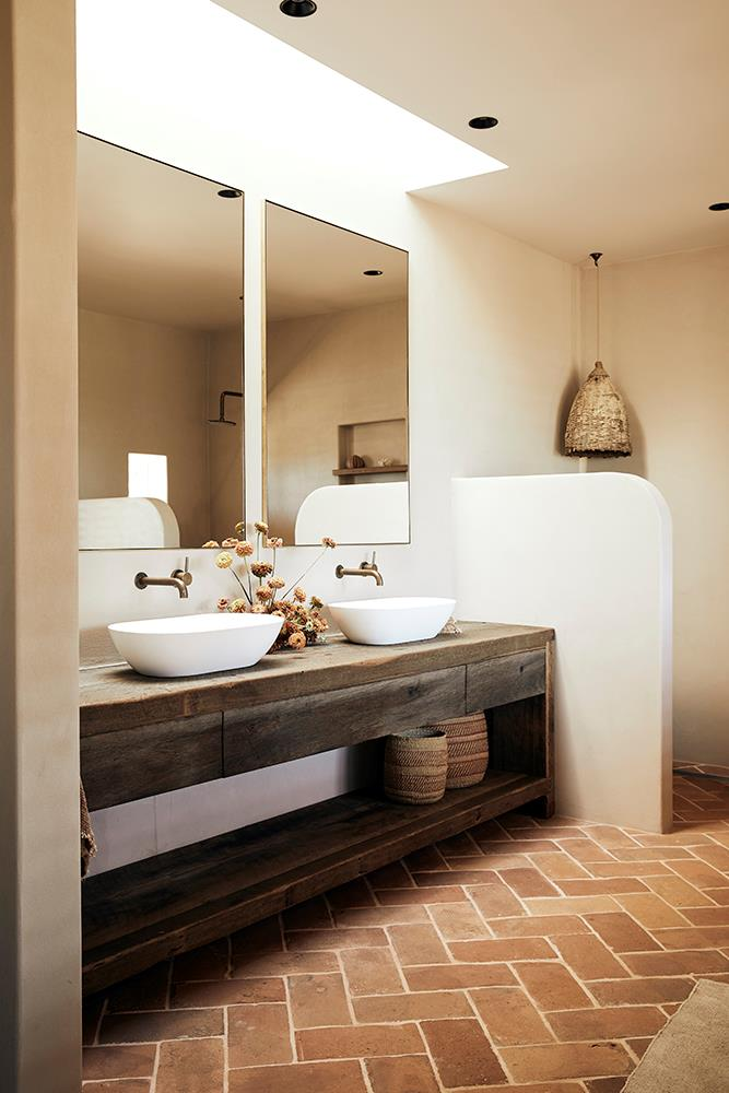 The bathrooms are fitted with wooden vanities and lots of rattan, creating a uniquely warm space.