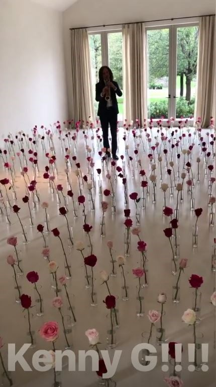 Kim Kardashian revealed that Kanye West hired saxophonist Kenny G to serenade her from within a field of single-stemmed roses.
