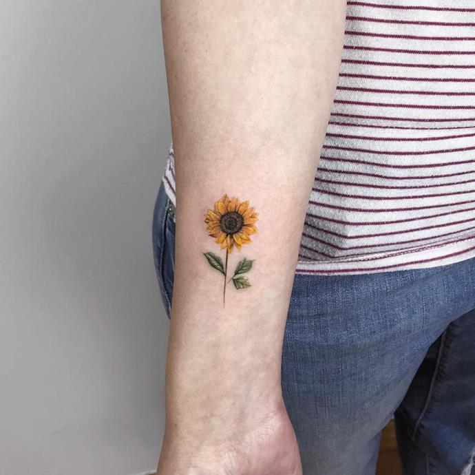***Sunflower Tattoos***<br><br> Although floral tattoos are always in style, sunflowers are breaking out as the flower design du jour. These look cute both in black and white, and in colour.<br><Br> Image via Pinterest.