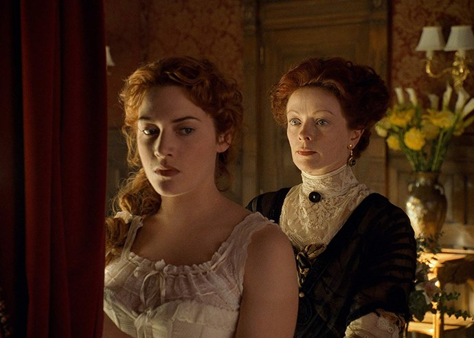 **Kate Winslet and Frances Fisher in *Titanic* (1997)** <br><br> For those who haven't seen *Titanic*—in which case, get *on* that—Frances Fisher plays main character Rose (Kate Winslet)'s conniving, social-climbing mother. Fisher and Winslet look similar in the first place, but with their hair dyed the same shade of red, the resemblance between the two is uncanny.