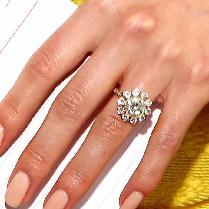 "Nikki Reed's ""daisy"" ring has all round diamonds."