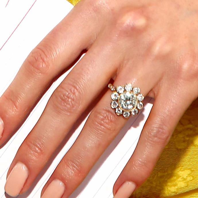 "Nikki Reed's ""daisy"" ring has all round diamonds."