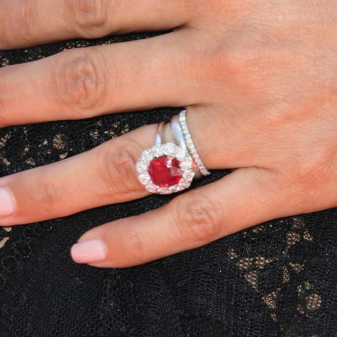 Eva Longoria's ring also features that distinctive diamond-halo around its red centre stone.