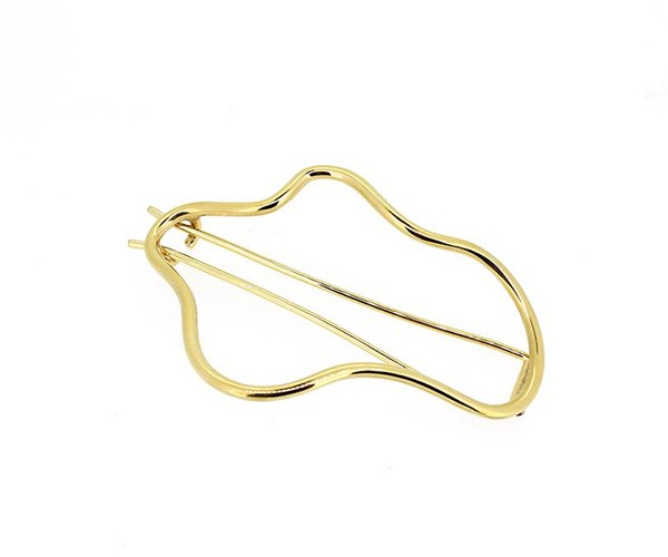 """Gold Squiggle Hair Barette, $360 from [Holly Ryan](https://hollyryan.com.au/collections/accessories/products/gold-squiggle-hair-barette
