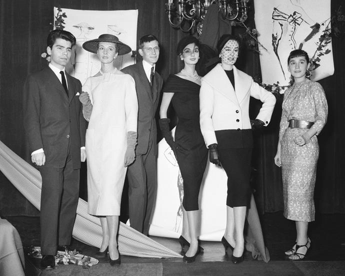 A 21-year-old Lagerfeld with an 18-year-old Yves Saint Laurent, and designer Colette Bracchi, among their creations. Lagerfeld and Saint Laurent were unknown fashion students at the time.