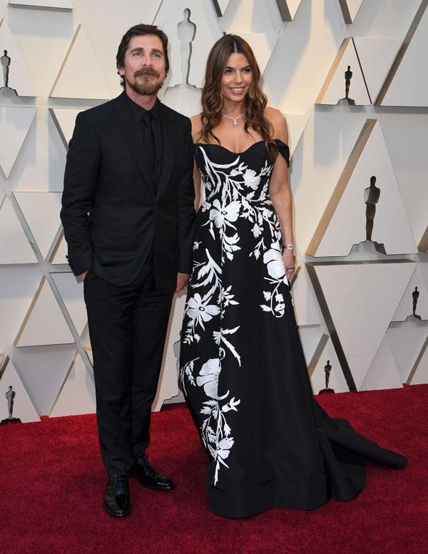 Adams' *Vice* co-star and best actor nominee Christian Bale with his wife of 19 years, Sibi Blazic.