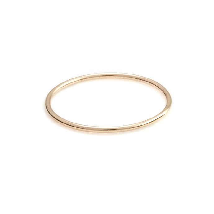 """***Barely-There***<br><Br> Meghan Markle' welsh gold wedding band might be a classic rounded style, but it's her other rings that are inspiring brides. The duchess' tiny thin gold bands, which she wears on her other fingers, have prompted searches for barely-there wire rings. Perfect for the low-key bride.<br><Br> Ring, $90 by [Sarah and Sebastian](https://www.sarahandsebastian.com/products/liberty-ring-gold