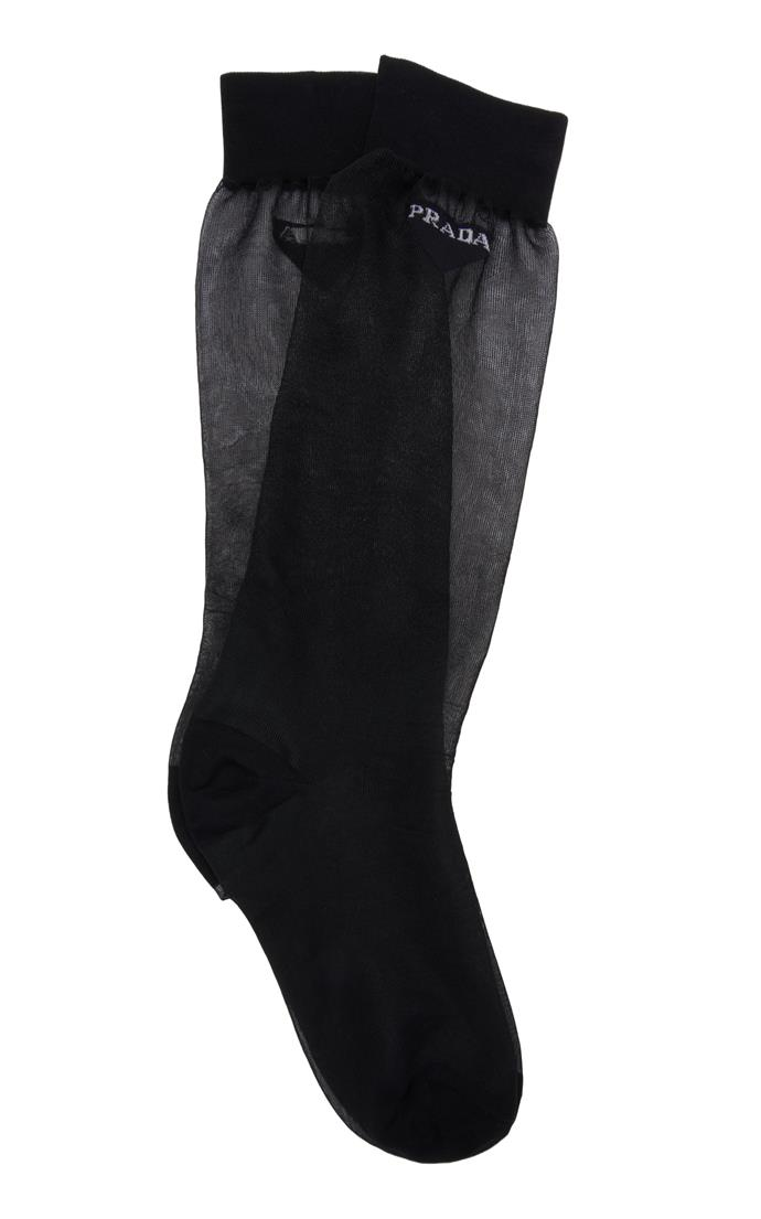 "**Buy:** Mesh Socks by Prada, $260 at [Moda Operandi](https://www.modaoperandi.com/prada-ss19/long-logo-socks?|target=""_blank""|rel=""nofollow"") <br> Logo Socks by Chloe, $105 at [Parlour X](https://www.parlourx.com/styles/socks/logo-sock-white-stripe.html|target=""_blank""|rel=""nofollow"")"