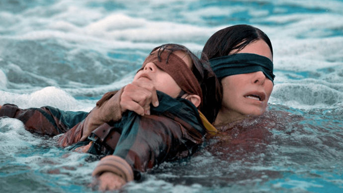 "***Bird Box*** <br><br> Five years after an ominous unseen presence drives most of society to suicide, a survivor and her two children make a desperate bid to reach safety. <br><br> Watch it [here](https://www.netflix.com/title/80196789|target=""_blank""