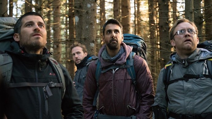 "***The Ritual*** <br><br> ""Four friends with a long-standing—but strained—connection take a hiking trip into the Swedish wilderness, from which they may never return."""