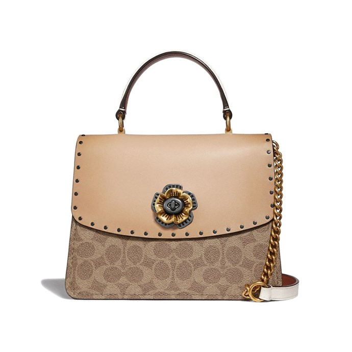 "Parker Top Handle Bag by [Coach](https://coachaustralia.com/product/parker-top-handle-in-signature-canvas-with-rivets?utm_source=elle&utm_medium=article&utm_campaign=sarah-ellen-elle&utm_content=text-link#C/53349V5ONI|target=""_blank""
