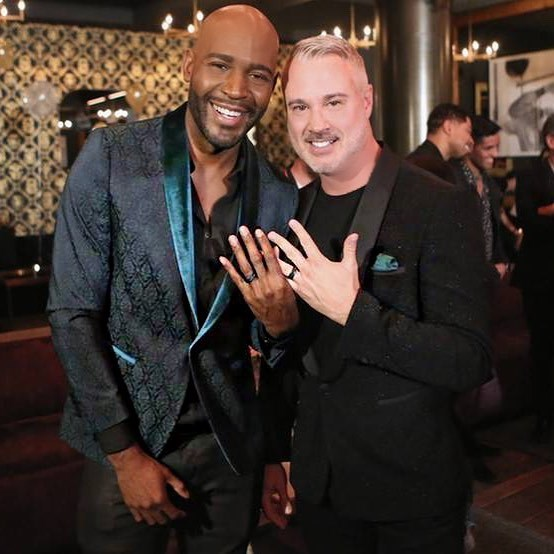 """They also recently upgraded their relationship status to """"engaged""""! **Karamo** revealed the news on Instagram, writing, """"Last night, in front of family & friends, I asked my best friend and the love of my life, """"will you marry me?"""" He said YESSS!!!! I'm engaged! Showing off our beautiful @davidyurmanmen rings. #LoveWins""""."""
