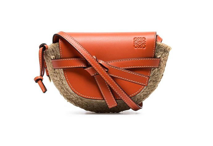 """Crafted from raffia and calf leather, this orange mini shoulder bag from Loewe will add a pop of colour to ensembles. Your mum will love its timeless appeal. <br><br> Bag by Loewe, $1,686 at [Farfetch](https://www.farfetch.com/au/shopping/women/loewe-orange-and-beige-gate-leather-and-raffia-mini-shoulder-bag-item-13549876.aspx?storeid=9359