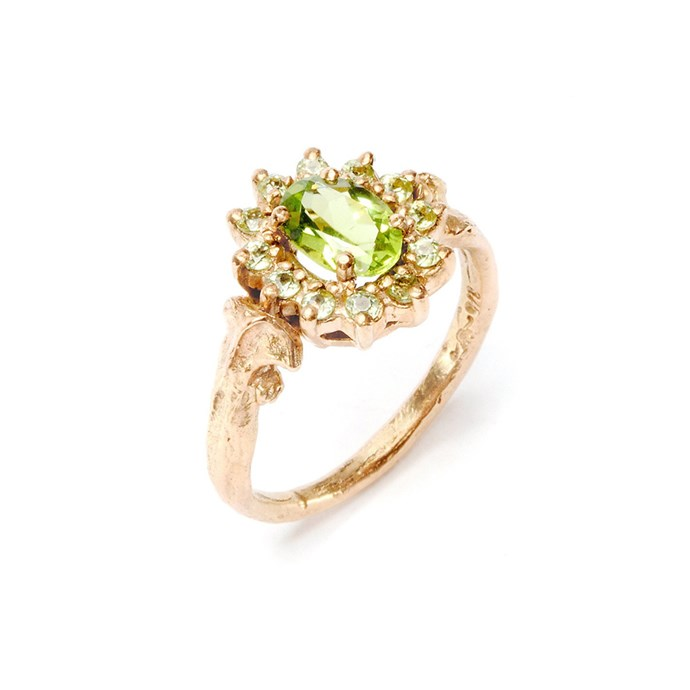 """***August: Peridot***<br><br> Rose gold and peridot ring, $1,290 at [Julia DeVille](http://www.juliadeville.com/shop/details/7329831171/bone-ring-elisabeth-poison/