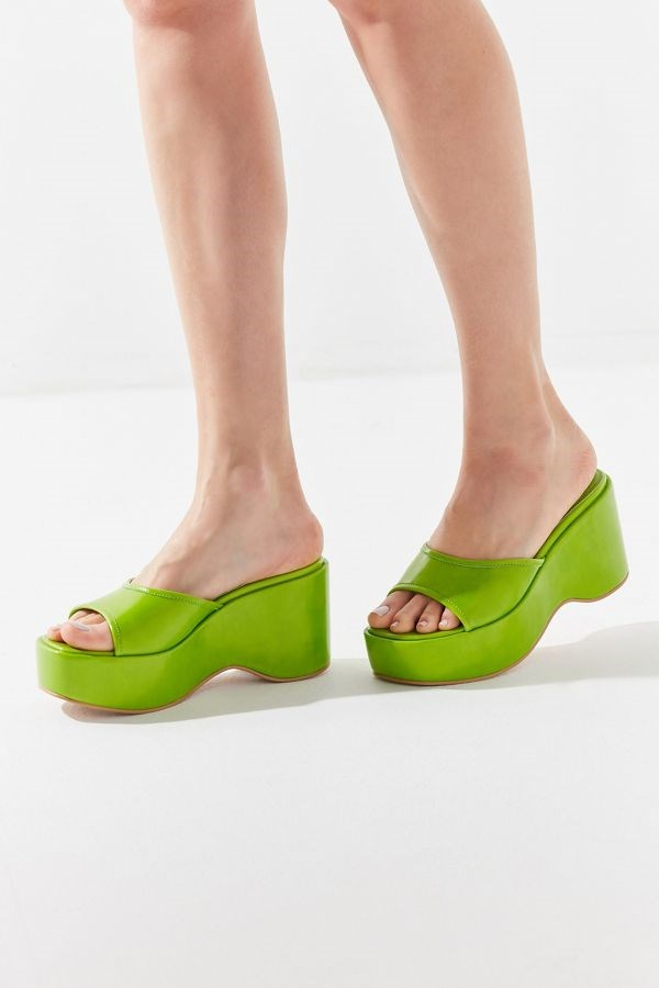"""Platform sandals by UO, $59 at [Urban Outfitters](https://www.urbanoutfitters.com/shop/uo-gina-platform-slide-sandal