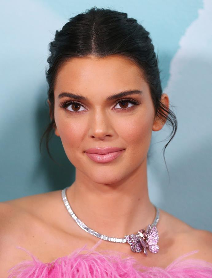 "Kendall Jenner at the opening of the [Tiffany & Co store](https://www.harpersbazaar.com.au/fashion/kendall-jenner-karl-lagerfeld-quote-18405|target=""_blank"") in Sydney wearing a sleek bun, minimal eye makeup and pink lips on April 4, 2019."