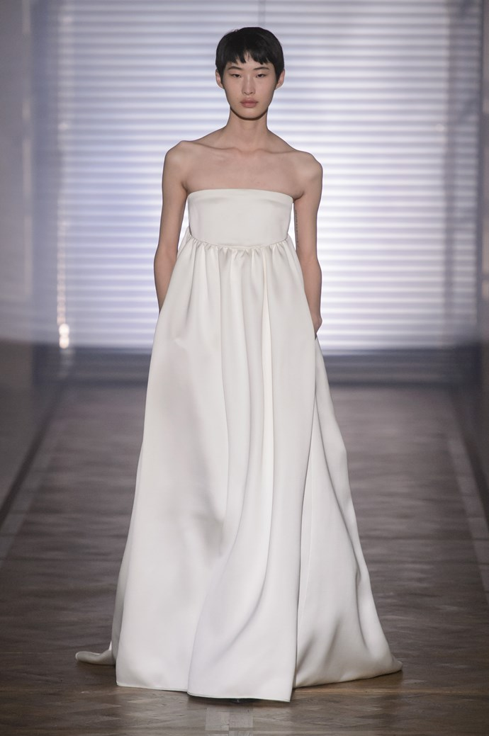 """**BEST BRIDAL GOWN** <br><br> *Givenchy by Clare Waight Keller, Spring 2018 Couture, Look 18* <br><br> """"Not from a bridal collection, but taken from couture. Claire Waight-Keller has had a huge year in terms of wedding dresses, designing the Duchess of Cambridge's iconic gown. This collection, in particular this dress, illustrates the strength of tailoring, in a feminine way. It is romantic yet simple and strong."""" <br><br> *Image: Jason Lloyd-Evans*"""