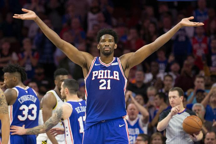 Basketball player Joel Embiid sings the line, 'We love you Africa'.