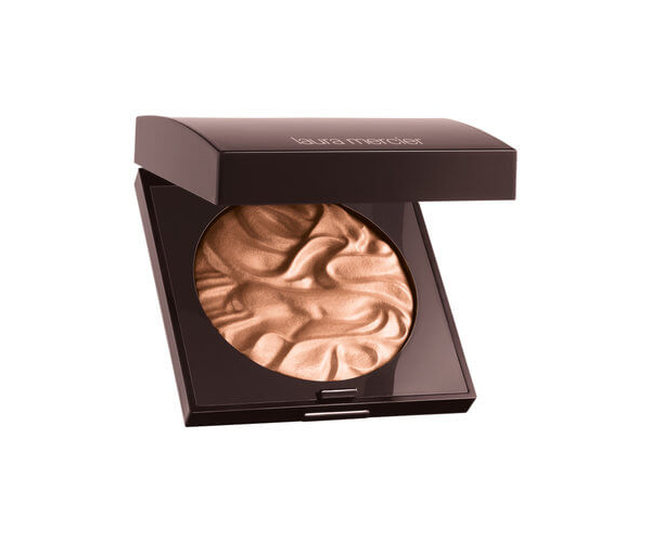 "**Illuminate your face with a highlighter** <br><br> A beautiful highlight can leave your skin looking dewy and more youthful. Apply a stroke of highlight on the tops of your cheekbones, brow bones and cupid's bow for a natural glow that will leave you looking and feeling refreshed.  <br><br> Laura Mercier Face Illuminator, $67, at [Mecca.](https://www.mecca.com.au/laura-mercier/face-illuminator-indiscretion/I-037957.html?gclid=CjwKCAjw_MnmBRAoEiwAPRRWWxxRX8ApcKLRQMY_LMS3WednEOt5UZi94F0TlU8-ZjCC6XLprdtnWhoCFEoQAvD_BwE|target=""_blank"")"