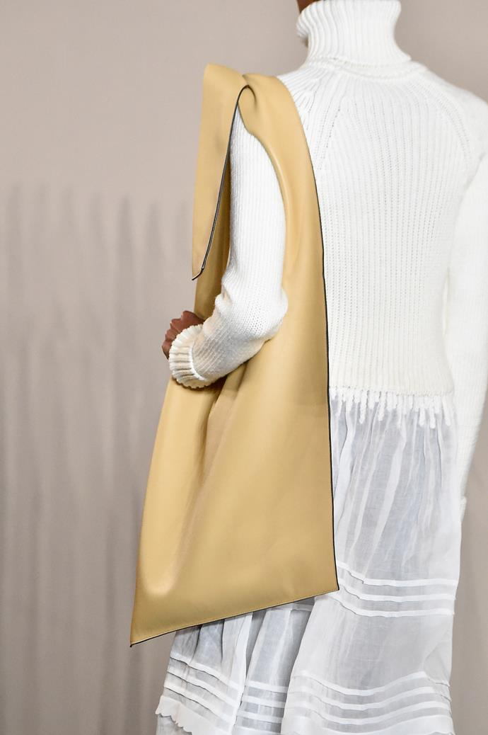 """**The Light Leather Handbag**<br><br>  """"Practicality is key, and this carry-all from Loewe is perfect. To keep the feel of summer even during the colder weather, opt for a light coloured leather to lift outfits,"""" said Wong."""