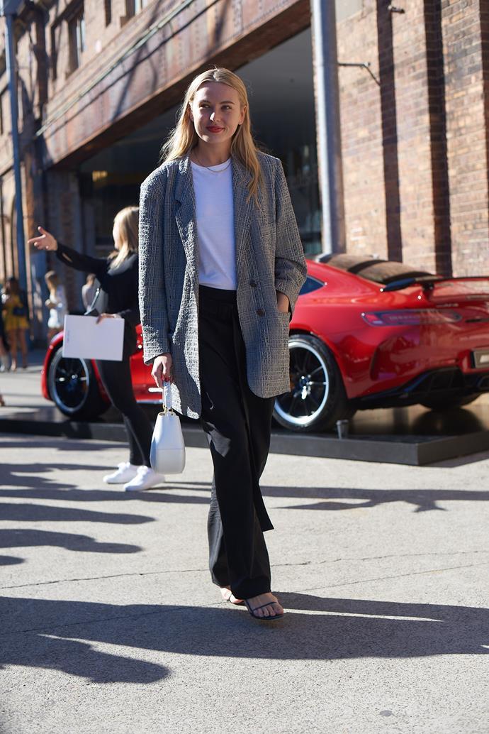 **Grace O'Neill, Fashion Features Director** <br><br> Ellery pants, Prada shirt, Christopher Esber blazer, The Row shoes and a Wandler handbag.