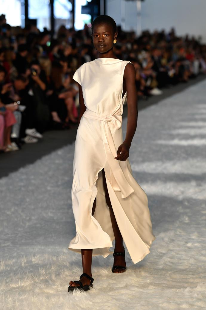 **Silky whites:** We loved the fluid eveningwear made of bright white silk. Keep the look grounded by eschewing heels for chunky sandals.  <br><br>Bec + Bridge Resort '20