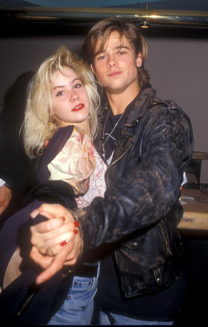 Rocking messy '80s hair and blue jeans with Christina Applegate.