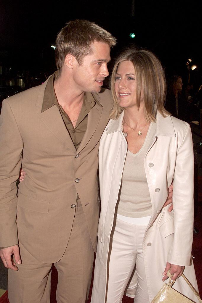 Neutral suiting and short, straight hair with Jennifer Aniston in 2001.