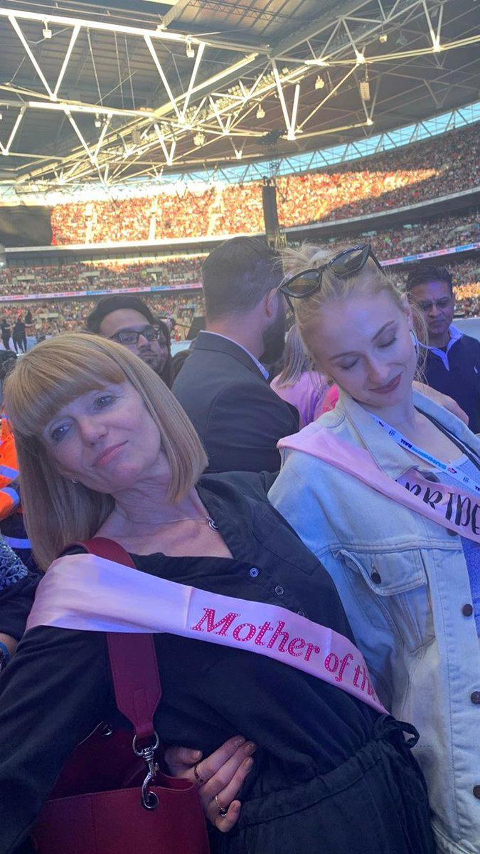 "**At the Jonas Brothers concert with her mama**<br><br>  Festivities appeared to commence off early in the weekend, with Turner photographed wearing a 'Bride to Be' sash at the Jonas Brothers' London concert alongside her mother.<br><br>  *Image via [@STurnerBrasil](https://twitter.com/STurnerBrasil/status/1137515147231203333/photo/1|target=""_blank""