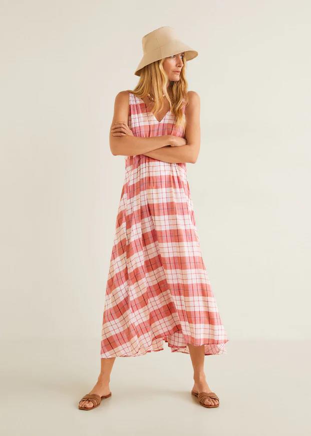 "Dress, $129.95 at [Mango](https://shop.mango.com/au/women/dresses-midi/checked-cotton-dress_43047020.html?c=70&n=1&s=prendas_she.familia;32.dresses32;Midi|target=""_blank""|rel=""nofollow"").<br><br> *Image via Mango.*"