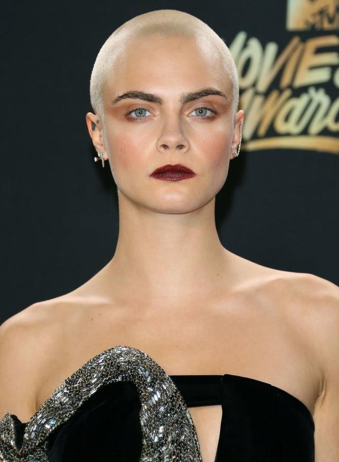 **Cara Delevingne's shaved head:** Leave it to the Brit 'It'-girl to pull off this no-holds-barred look. We almost prefer her head bare than with hair.