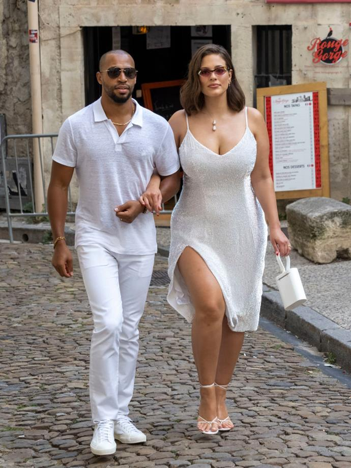 Ashley Graham and her husband, Justin Ervin, make their way to the rehearsal dinner.