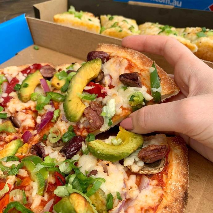 **Three vegan pizzas at Domino's**<br> <br>  Domino's menu features three vegan pizzas made with non-dairy cheese, including the 'Vegan Avocado Veg', 'Vegan Margherita' and the 'Vegan Spicy Veg Trio'. Many of the others can be made vegan if you request no cheese. Oh, and they even have 'Vegan Cheesy Garlic Bread' to complement their already vegan traditional garlic bread.<br><br>