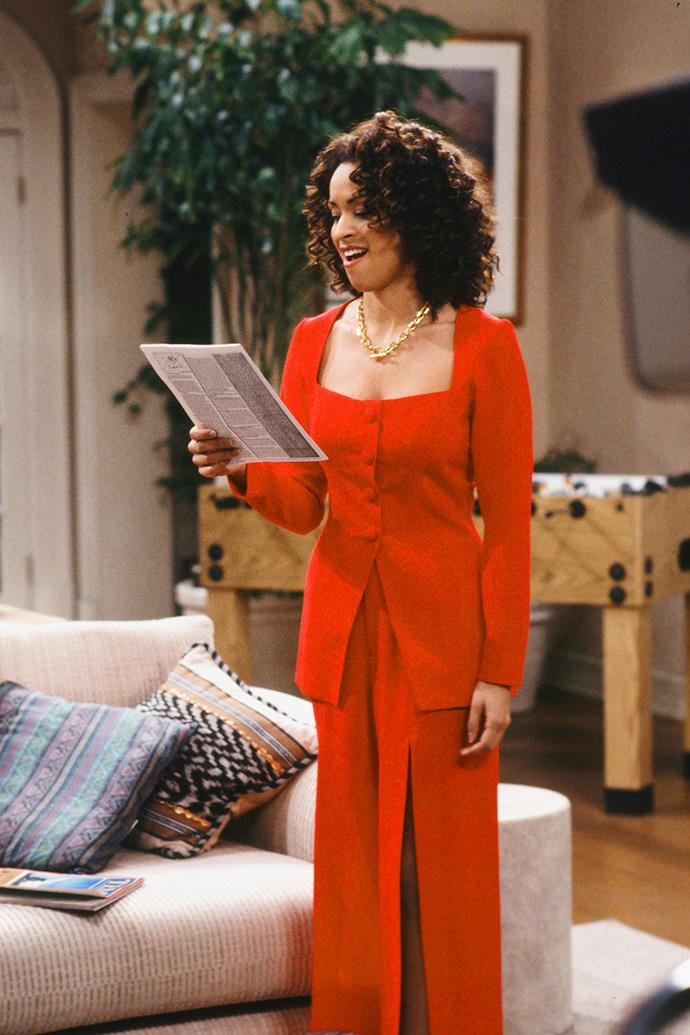 In order to make a statement, one requires the following ingredients: Hilary's tailored red blazer, Hilary's red palazzo pants with daring leg slits. Hilary's hair. Hilary's everything.