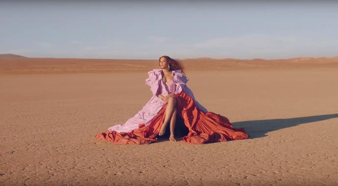 She opened the video in the desert with a tiered haute couture gown by Valentino.