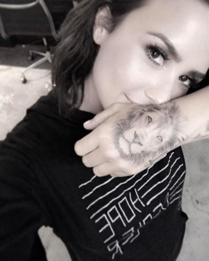 Demi Lovato got this lion face to cover the entire back of her hand.